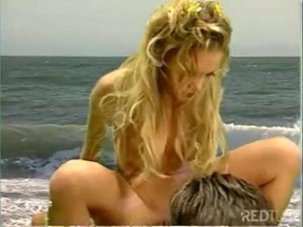 Chupando um pau na praia